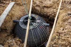 new septic tank being installed
