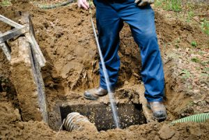 worker cleaning septic tank