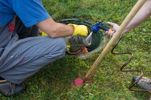 cleaning and unblocking septic system and draining pipes.